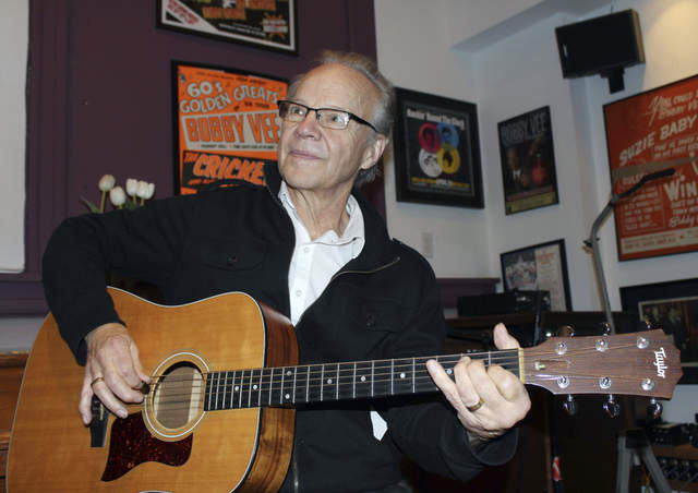 Bobby Vee plays the guitar at his family's Rockhouse Productions in St. Joseph, Minn., Dec. 18, 2013. Vee, 73, died Monday Oct. 24, 2016 of complications from Alzheimer's disease. (Jeff Baenen/AP)