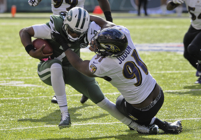 New York Jets quarterback Geno Smith (7) is sacked by Baltimore Ravens linebacker Matt Judon (91) during the second quarter of an NFL football game, Sunday, Oct. 23, 2016, in East Rutherford, N.J. ...