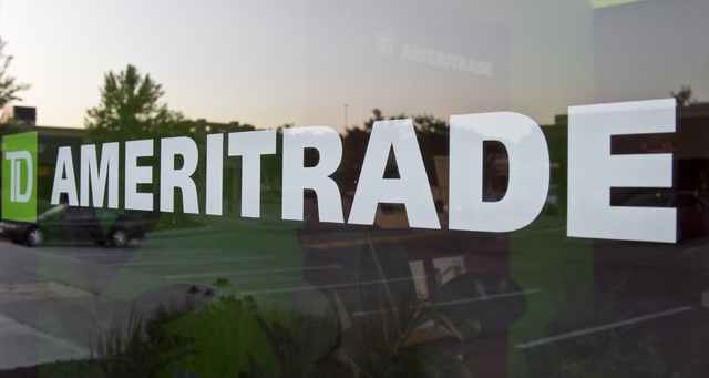 In this July 18, 2010, file photo, a TD Ameritrade logo is displayed on the office in Omaha, Neb. (AP Photo/Nati Harnik, File)