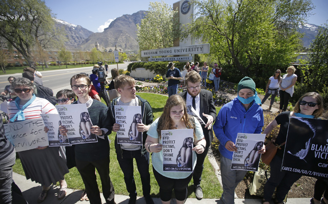Protesters stand in solidarity with rape victims on the campus of Brigham Young University during a sexual assault awareness demonstration, in Provo, Utah. (Rick Bowmer/AP)