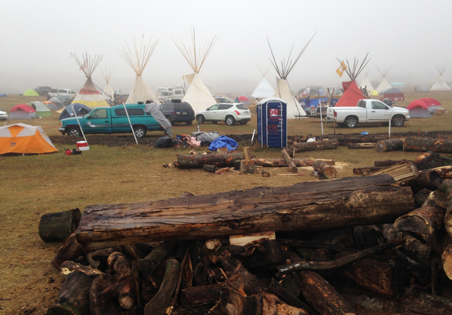 Protesters of the Dakota Access pipeline encampment sits Wednesday, Oct. 26, 2016, on private property near Cannon Ball, N.D., owned by the pipeline developer, Texas-based Energy Transfer Partners ...