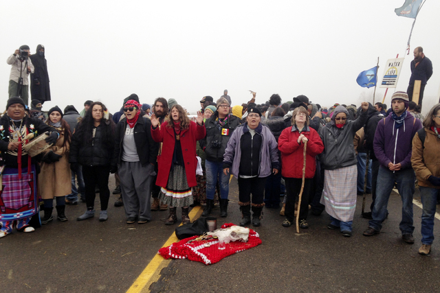 Protesters against the construction of the Dakota Access oil pipeline block a highway in near Cannon Ball, N.D., on Wednesday, Oct. 26, 2016. (James MacPherson/AP)