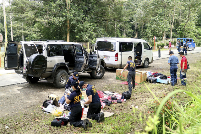 Police inspect the contents of the vehicles following an operation Friday, Oct. 28, 2016 at Makilala township, North Cotabato province in southern Philippines. Philippine police say Mayor Samsudin ...