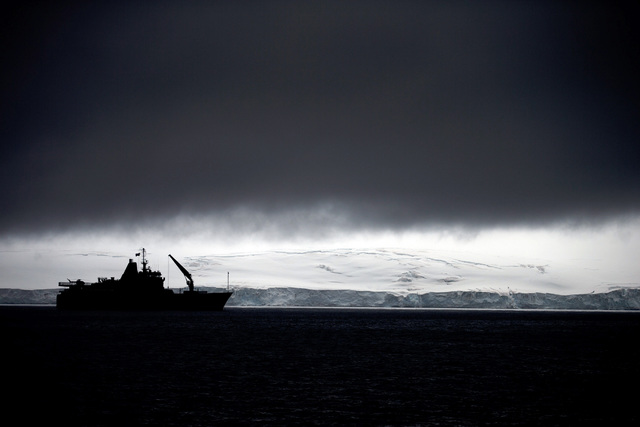 In this Jan. 25, 2015 photo, Chile's Navy ship Aquiles moves alongside the Hurd Peninsula, seen from Livingston Islands, in Antarctica. The countries that decide the fate of Antarctica agreed on F ...