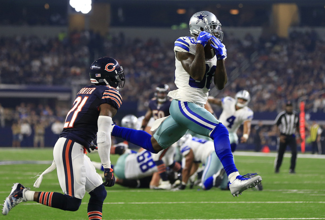In this Sept. 25, 2016, file photo, Chicago Bears cornerback Tracy Porter (21) defends as Dallas Cowboys wide receiver Dez Bryant (88) catches a pass thrown by Dak Prescott (4) for a touchdown in  ...