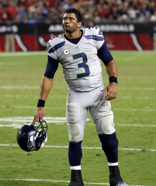 In this Oct. 23, 2016, file photo, Seattle Seahawks quarterback Russell Wilson (3) reacts after a missed game-winning field goal attempt during overtime of an NFL football game against the Arizona ...