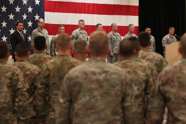 Lt. Jimmy Green, right, speaks during a mobilization ceremony for the Nevada Army National Guard's 72nd Military Police Company Thursday, May 28, 2015 at the Gold Coast. The unit is deploying to A ...