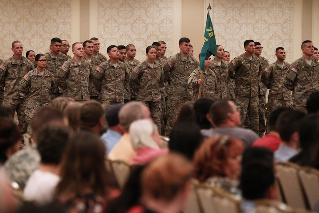 Members of the Nevada Army National Guard's 72nd Military Police Company stand at rest during a deployment ceremony Thursday, May 28, 2015 at the Gold Coast. The unit is deploying to Afghanistan t ...