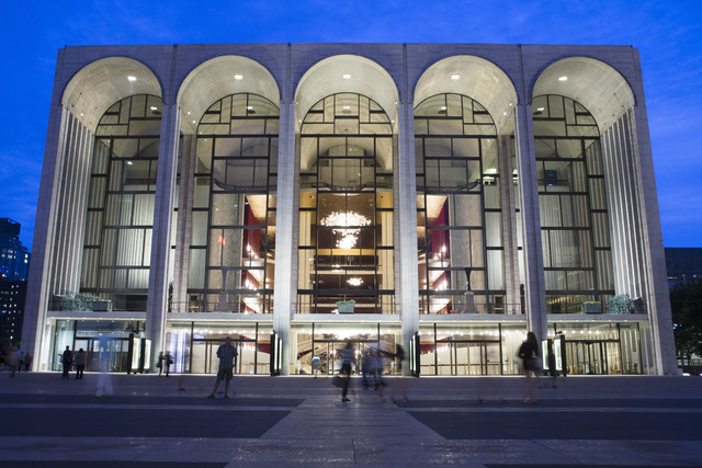 Pedestrians make their way in front of the Metropolitan Opera house at New York's Lincoln Center Aug. 1, 2014. New York's Metropolitan Opera stopped a performance Saturday, Oct. 29, 2016, after so ...