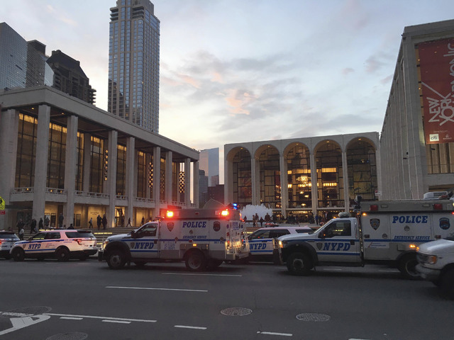 Police respond to New York's Metropolitan Opera which halted a performance after someone sprinkled an unknown powder into the orchestra pit, Saturday, Oct. 29, 2016. Met spokesman Sam Neuman said  ...