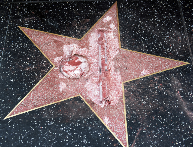 The vandalized star for Republican presidential candidate Donald Trump is seen on the Hollywood Walk of Fame, Wednesday, Oct. 26, 2016, in Los Angeles. Detective Meghan Aguilar said investigators  ...