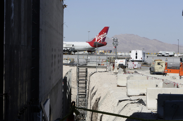 A Virgin Atlantic Boeing aircraft is parked outside a hangar on Friday, Sept. 9, 2016, during the ongoing construction at McCarranճ Terminal D satellite concourse, including seven new airlin ...