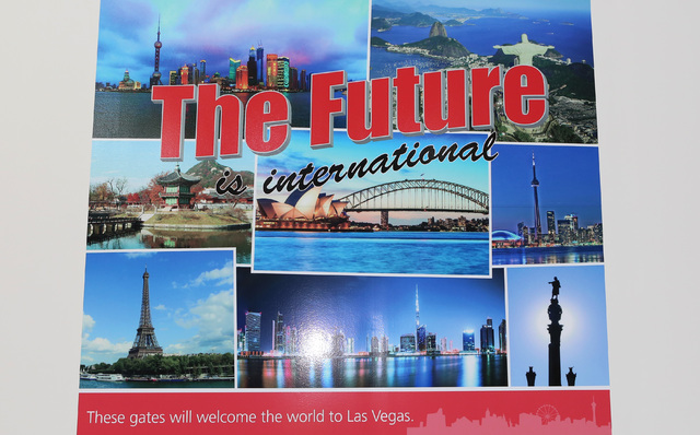 A poster that reads 'The Future is International' is posted during the ongoing construction at McCarranճ Terminal D satellite concourse, including seven new airline gates for international f ...