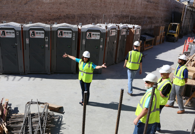 Clark County Director of Aviation Rosemary Vassiliadis, left, speaks during a media tour of the ongoing construction, including seven new airline gates for international flights and a half-mile tu ...