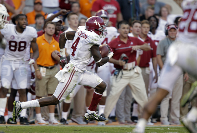 Alabama defensive back Eddie Jackson (4) returns a punt for a 79-yard touchdown during the second half of an NCAA college football game against Tennessee Saturday, Oct. 15, 2016, in Knoxville, Ten ...