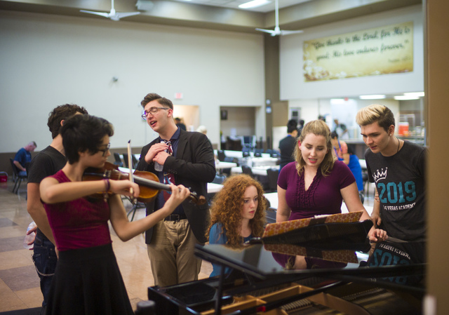 """Between dinner performances at the Las Vegas Rescue Mission, current and former Las Vegas Academy students participating in Notes With a Purpose jam together on Queen's """"Bohemian Rhapsody."""" Chase  ..."""