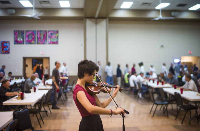 Las Vegas Academy sophomore Geneva Rucker performs for diners at the Las Vegas Rescue Mission as part of Notes With a Purpose. Chase Stevens/Las Vegas Review-Journal Follow @csstevensphoto