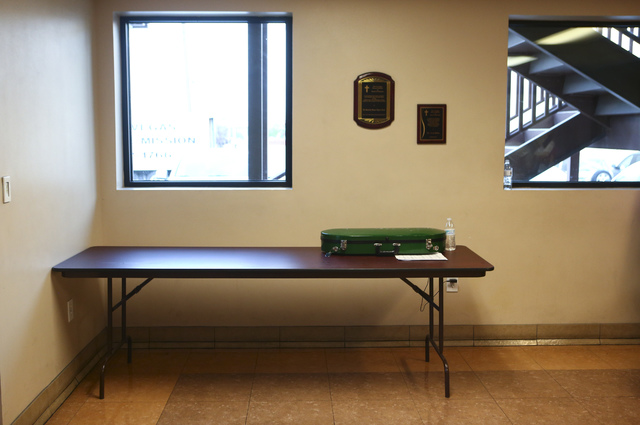 An instrument case and music notes rest on a table outside the Las Vegas Rescue Mission's dining hall, the location for weekly performances organized by the local non-profit Notes With Purpose. Ch ...