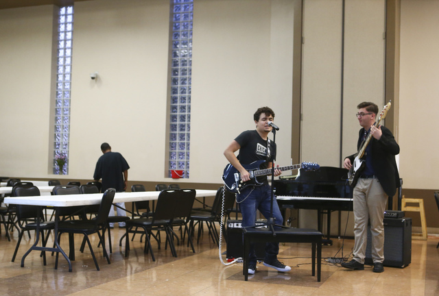 Participating in Notes With a Purpose's weekly music sessions at the Las Vegas Rescue Mission, Las Vegas Academy graduate Anthony Aceves, left, and UNLV student Michael Westlake perform a blues du ...