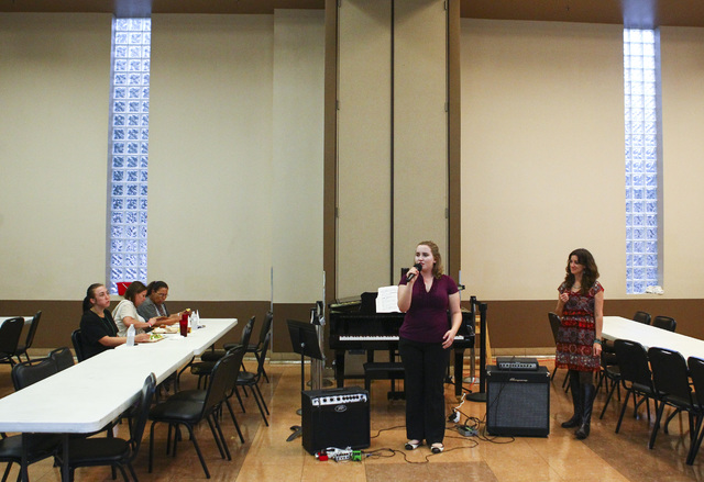 Las Vegas Academy piano student Megan Pridmore, center, introduces a song while diners look on during Notes With a Purpose's Wednesday night music programs at the Las Vegas Rescue Mission. Chase S ...