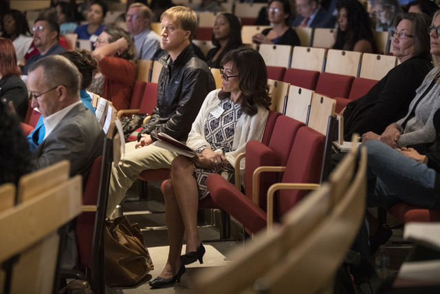 Michelle Paul, front, and Erik Schoen listen to a speaker at the Mental and Behavioral Health Coalition forum at UNLV Oct. 7, 2016, in Las Vegas. Loren Townsley/View Follow @lorentownsley