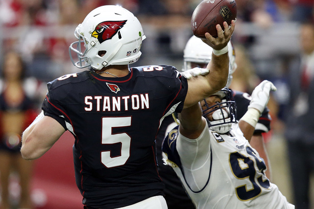 Arizona Cardinals quarterback Drew Stanton (5) is hit by Los Angeles Rams defensive tackle Aaron Donald (99) during the second half of an NFL football game, Sunday, Oct. 2, 2016, in Glendale, Ariz ...