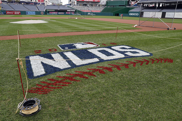 The NLDS baseball logo is seen painted on the field at Nationals Park, Thursday, Oct. 6, 2016, in Washington. (Alex Brandon/AP)