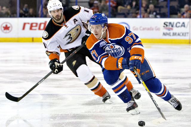 In this March 28, 2016, file photo, Anaheim Ducks' Ryan Kesler (17) chases Edmonton Oilers' Connor McDavid (97) during first period NHL action in Edmonton, Alberta. McDavid is one of the top playe ...