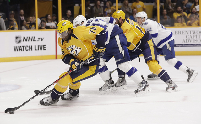 In this Oct. 1, 2016, file photo, Nashville Predators defenseman P.K. Subban (76) clears the puck away from Tampa Bay Lightning center Cedric Paquette (13) during the third period of an NHL hockey ...