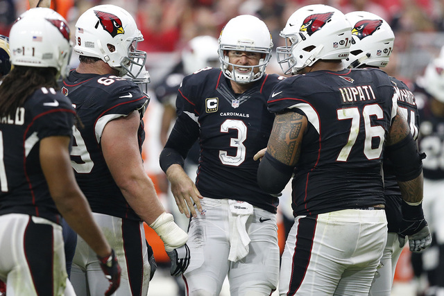 Arizona Cardinals quarterback Carson Palmer (3) is helped up after a getting sacked against the Los Angeles Rams during an NFL football game in Glendale, Ariz., Oct. 2, 2016, (Ross D. Franklin, Fi ...