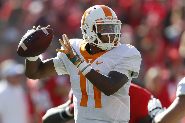 Tennessee quarterback Joshua Dobbs throws from the pocket in the first half of an NCAA college football game against Georgia in Athens, Ga., Oct. 1, 2016. (John Bazemore/AP)