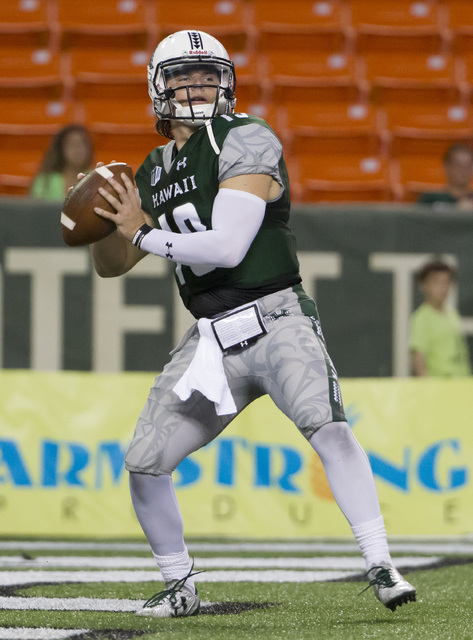 Hawaii quarterback Dru Brown drops back to pass during the first quarter of an NCAA college football game against UNLV, Saturday, Oct. 15, 2016, in Honolulu. (Eugene Tanner/AP)