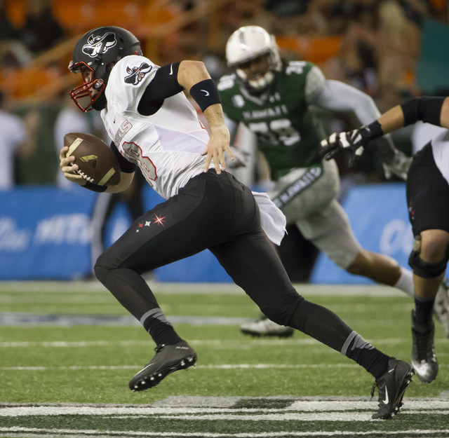 UNLV quarterback Dalton Sneed (18) scrambles out of the backfield during the first quarter of an NCAA college football game against Hawaii, Saturday, Oct. 15, 2016, in Honolulu. (Eugene Tanner/AP)