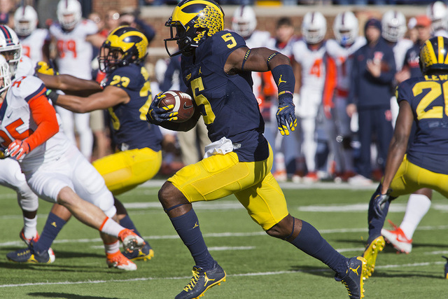 Michigan linebacker Jabrill Peppers (5) returns a kickoff in the first quarter of an NCAA college football game against Illinois at Michigan Stadium in Ann Arbor, Mich., Saturday, Oct. 22, 2016. M ...