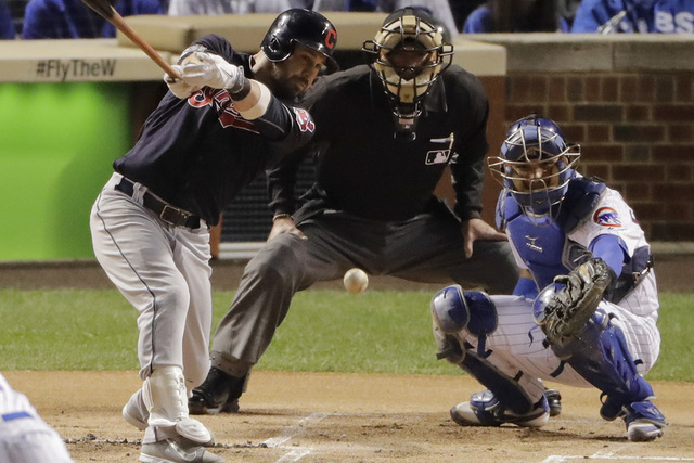 Cleveland Indians' Jason Kipnis hits a single against the Chicago Cubs during the first inning of Game 3 of the Major League Baseball World Series Friday, Oct. 28, 2016, in Chicago. (Charlie Riede ...