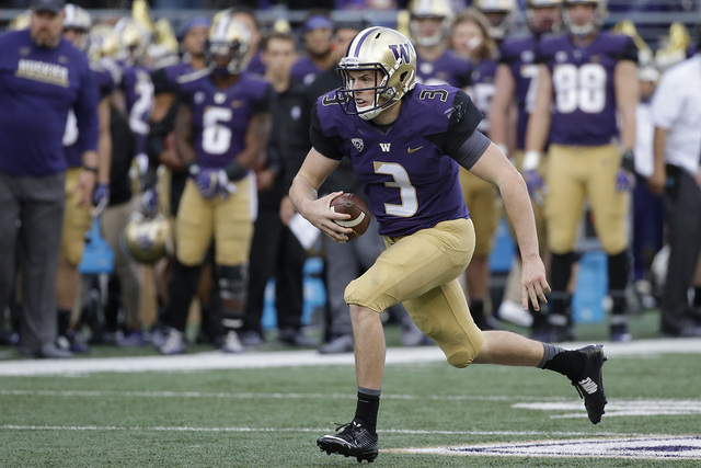 Washington quarterback Jake Browning carries the ball against Oregon State in an NCAA college football game Saturday, Oct. 22, 2016, in Seattle. (Elaine Thompson/AP)