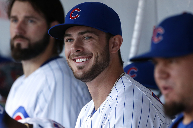 Chicago Cubs' Kris Bryant smiles as he looks to the field before a baseball game against the Pittsburgh Pirates, Wednesday, Aug. 31, 2016, in Chicago. (Nam Y. Huh/AP)