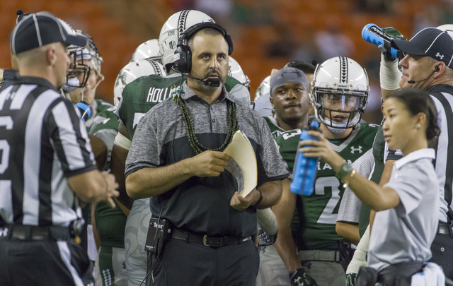 Hawaii head coach Nick Rolovich looks up at the scoreboard during a timeout in the third quarter of an NCAA college football game, Saturday, Oct. 1, 2016, in Honolulu. (Eugene Tanner/AP)