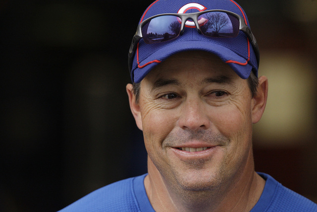 Former Chicago Cubs pitcher Greg Maddux, now assistant to the general manager, smiles during spring training baseball camp Saturday, Feb. 20, 2010, in Mesa, Ariz. (Ross D. Franklin/AP)