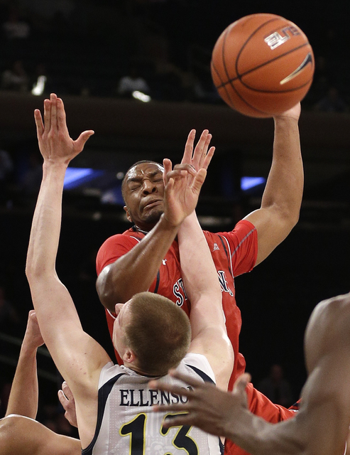 St. John's forward Christian Jones (2) loses control of the ball as he goes up to shoot against Marquette forward Henry Ellenson (13) in the second half of an NCAA college basketball game during t ...