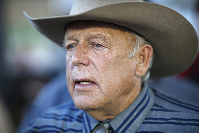 In this April 11, 2015, file photo, Nevada rancher Cliven Bundy speaks with supporters at an event in Bunkerville, Nev.  (AP Photo/John Locher, File)