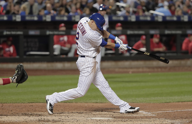 New York Mets' Gavin Cecchini swings for his first hit in the majors, driving in a run during the sixth inning of a baseball game against the Philadelphia Phillies, Saturday, Sept. 24, 2016, in Ne ...