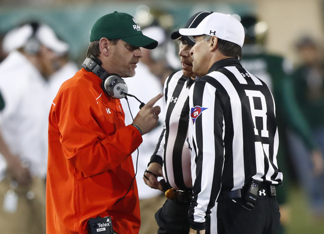Colorado State Rams head coach Mike Bobo, left, talks to referee Brad Van Vark while facing Utah State in the first half of an NCAA college football game Saturday, Oct. 8, 2016, in Fort Collins, C ...