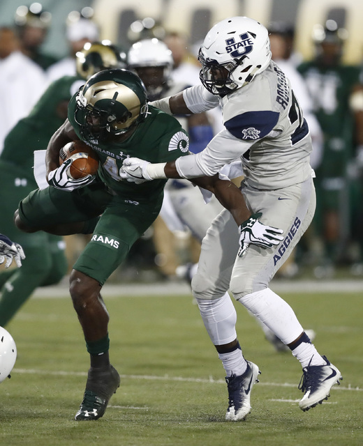 Colorado State wide receiver Michael Gallup, left, is stopped after a short win by Utah State safety Jontrell Rocquemore in the first half of an NCAA college football game Saturday, Oct. 8, 2016,  ...