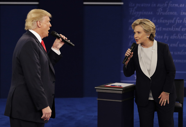 Republican presidential nominee Donald Trump and Democratic presidential nominee Hillary Clinton speak during the second presidential debate at Washington University in St. Louis, Sunday, Oct. 9,  ...