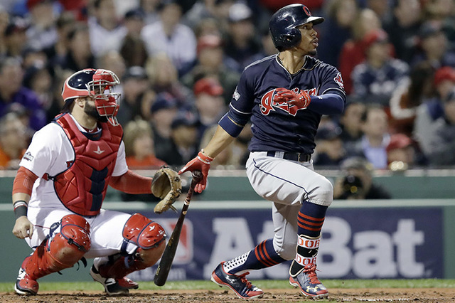 Cleveland Indians' Francisco Lindor, right, watches his double hit to deep left center field, as Boston Red Sox catcher Sandy Leon watches during the third inning in Game 3 of baseball's American  ...
