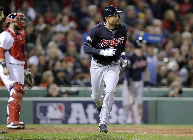 Cleveland Indians' Coco Crisp, right, watches his two-run home run off Boston Red Sox  relief pitcher Drew Pomeranz during the sixth inning in Game 3 of baseball's American League Division Series, ...