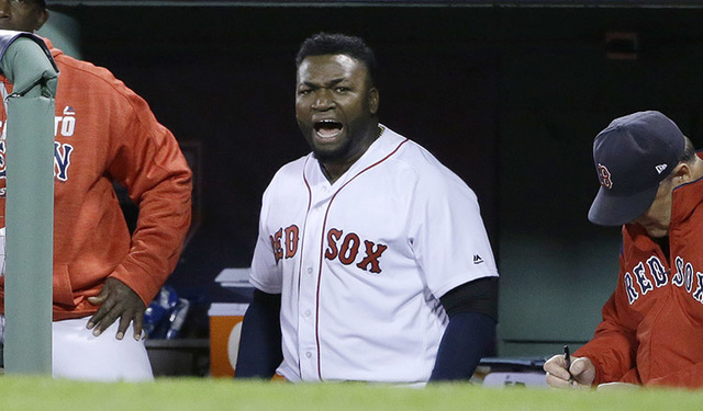 Boston Red Sox designated hitter David Ortiz encourages the crowd from the dugout during the eighth inning in Game 3 of baseball's American League Division Series against the Cleveland Indians, Mo ...
