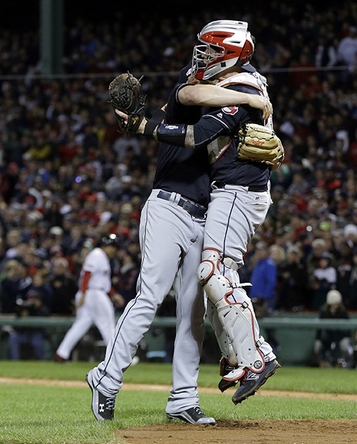 Cleveland Indians relief pitcher Cody Allen, left, and catcher Roberto Perez celebrate their 4-3 win over the Boston Red Sox in Game 3 of baseball's American League Division Series, Monday, Oct. 1 ...