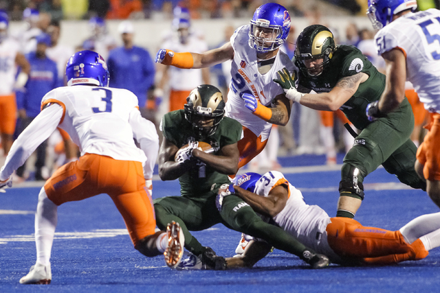 Colorado State running back Dalyn Dawkins (1) is brought down by Boise State safety Cameron Hartsfield (37) during the first half of an NCAA college football game in Boise, Idaho, Saturday, Oct. 1 ...